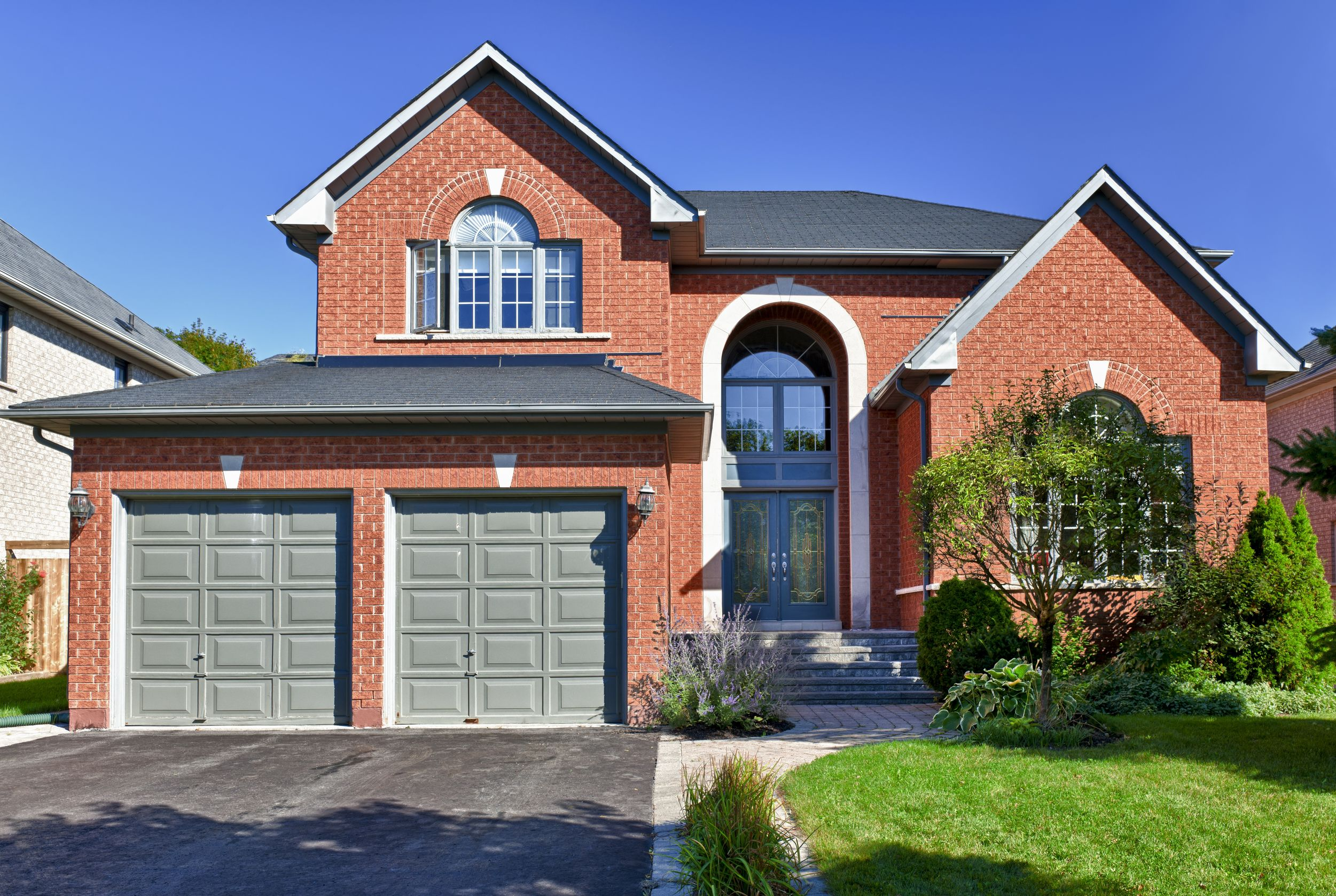 11177365 – brick house in suburbs with two car garage